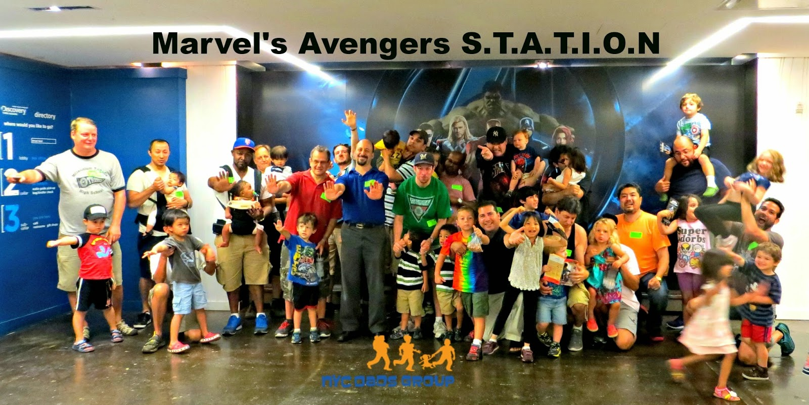 NYC Dads Group pose as superheroes at Marvel's Avengers S.T.A.T.I.O.N Exhibit