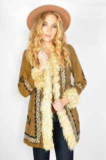 Vintage 1970's brown suede and Mongolian fur hippie style coat with embroidery.