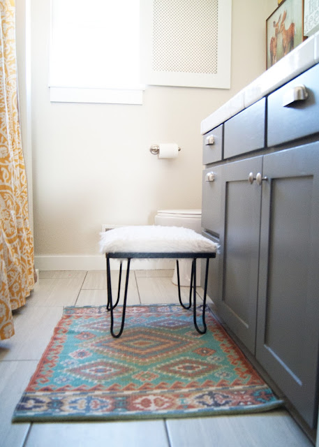 Bathroom Makeover - before & after - World Market rug / mat and vintage hairpin leg stool