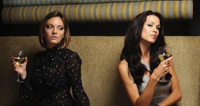 Toxic Friends - women drinking vodka in a glass in a club