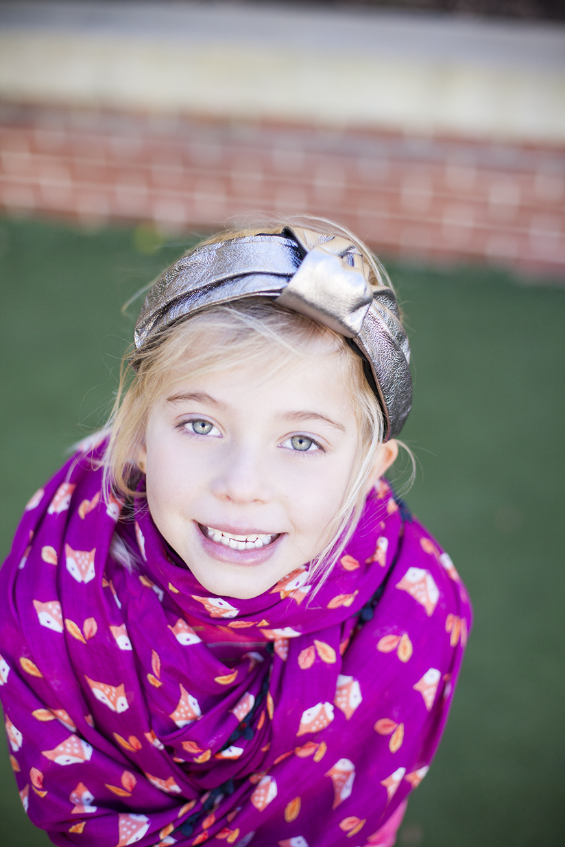 little girl in head band and scarf by Anthropologie