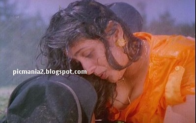 Suchitra boobs popping out rare cleavage show in wet image gallery