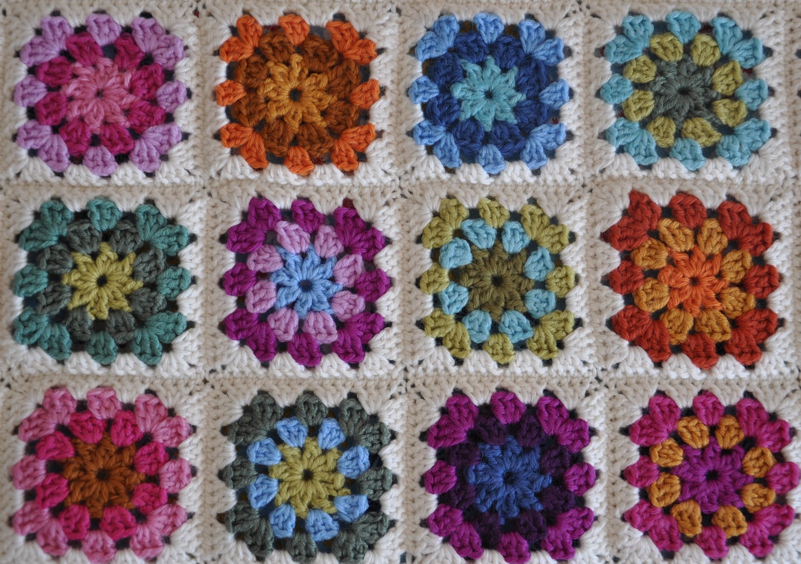 The square pattern is Summer Garden Granny Square by Attic 24