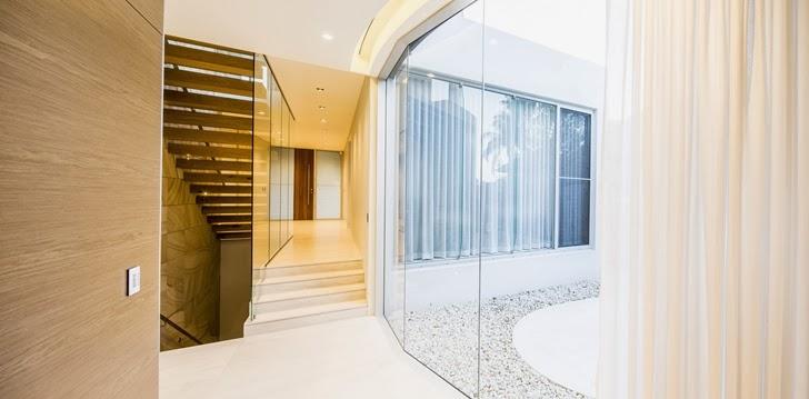 Thin glass wall in Beautiful Box House by Zouk Architects