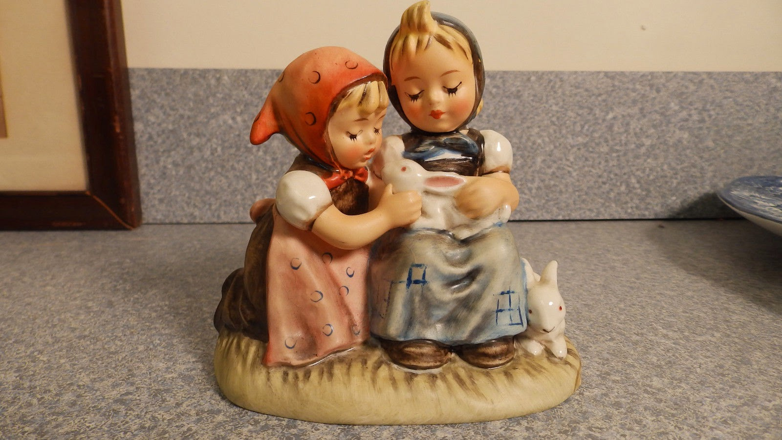 http://www.ebay.com/itm/Goebel-Easter-Time-Hummel-figurine-Girls-bunnies-rabbits-384-TMK-5-/321690545267?pt=LH_DefaultDomain_0&hash=item4ae6402c73