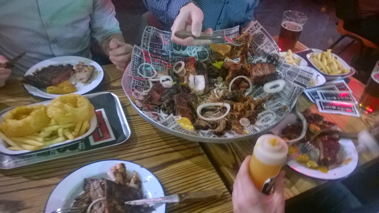 A dustbin lid full of meat, and beers