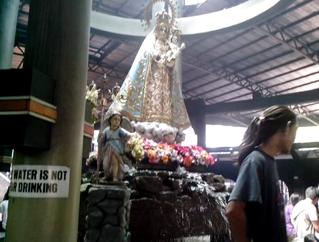 Our Lady of Manaoag Church - Get a bottle or two of supposedly miraculous, healing water.