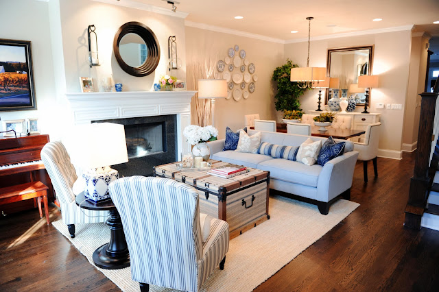 a living room in coastal style shows uniqueness with its crest-like table