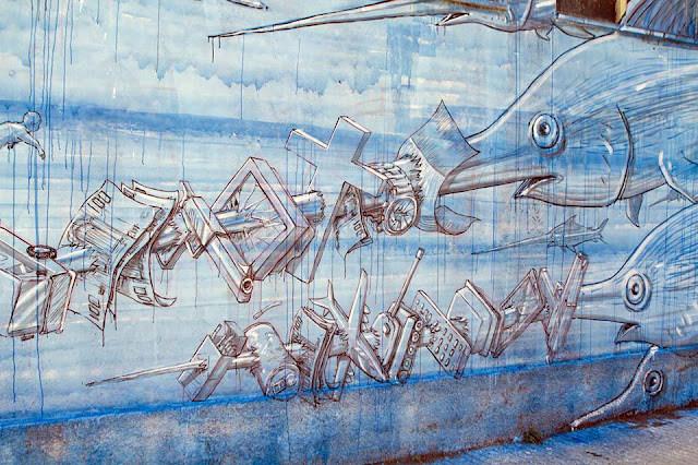 Street Art By Blu in Messina At Teatro Pinelli Occupato.- fish details