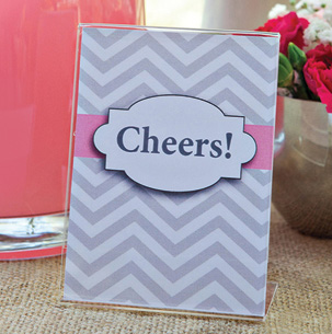 "the Deflecto 3"" x 4"" Mini Slanted Sign Holder to create fancy place cards."