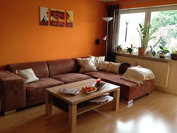 10 salas color naranja salas con estilo for Combinacion de colores para paredes de sala
