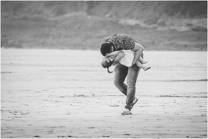 A father playing with his daughter