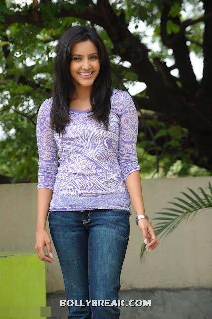Priya Anand in blue jeans and Blue top in different poses - Priya Anand photoshoot pics