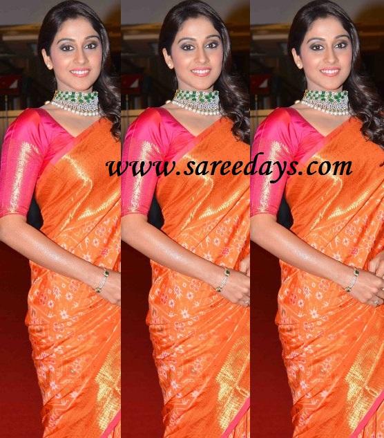 Latest saree designs regina in orange silk saree checkout regina in orange silk saree with zari work and zari border and paired with contrast pink half sleeves blouse altavistaventures Images