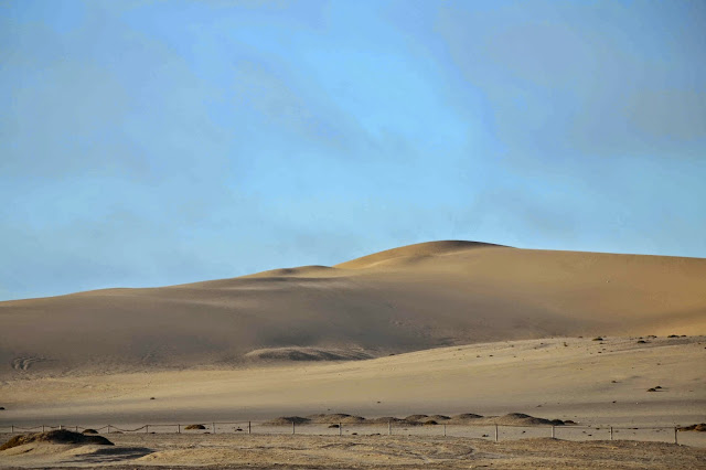 White sand dunes with blue sky