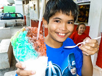 My son Alaka'i having shaved ice.