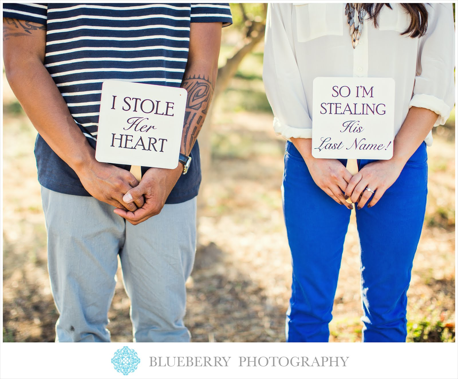 cute_fun_signs_vineyard_engagement_photo