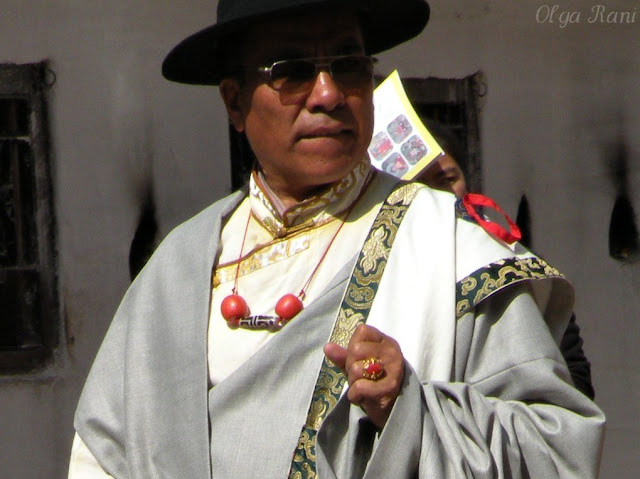 Tibetan man wearing dzi and coral beads necklace and coral ring