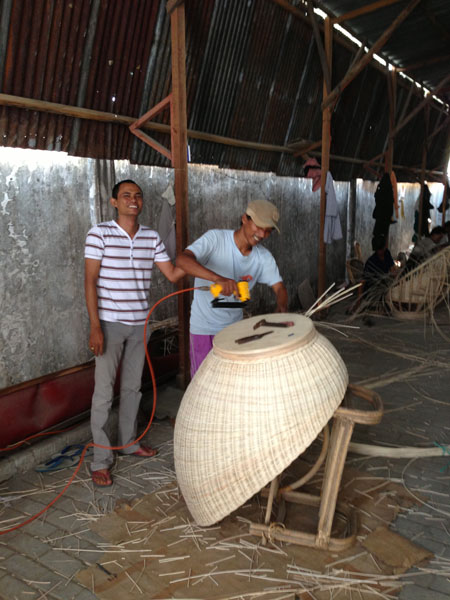 The Indonesian workers finishing off the Rattan Swivel Chair