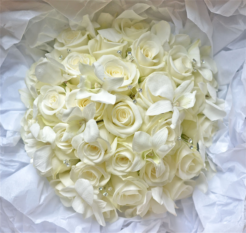 Wedding flowers blog laurens white and silver wedding flowers all white bouquet of akito roses singapore orchids and sprays of diamante to give a touch of sparkle for our bride photos dont really do this design mightylinksfo