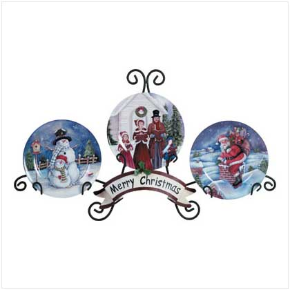 this holiday plate display includes an attractive green metal stand that holds three decorative plates featuring traditional holiday scenes of snowmen - Decorative Christmas Display Plates