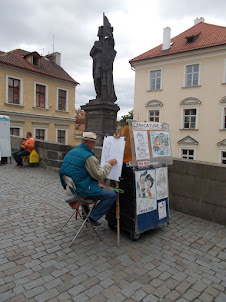 """Sketching Prague landscapes on """"Charles Bridge""""."""