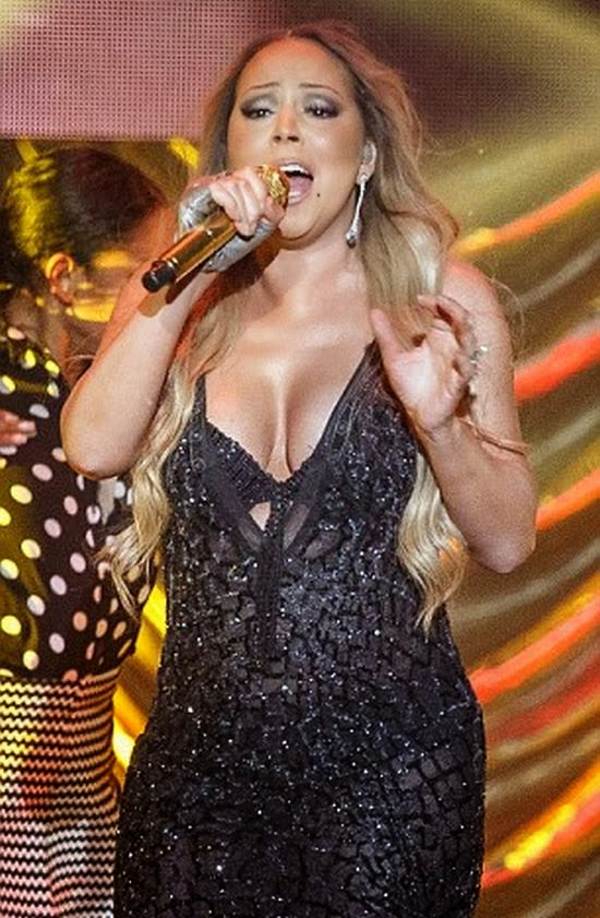 The 44-year-old looked sultry in a black gown as she returned to concert duties at Sydney's Qantas Credit Union Arena in Sydney, Australia on Monday, November 10, 2014.