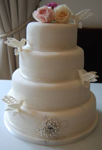 Four Tier White Vintage Wedding Cake Decorated With Sugar LoveBirds And