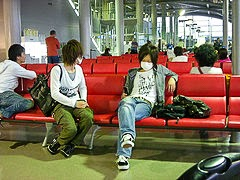 Surgical masks being worn at Kansai International Airport.