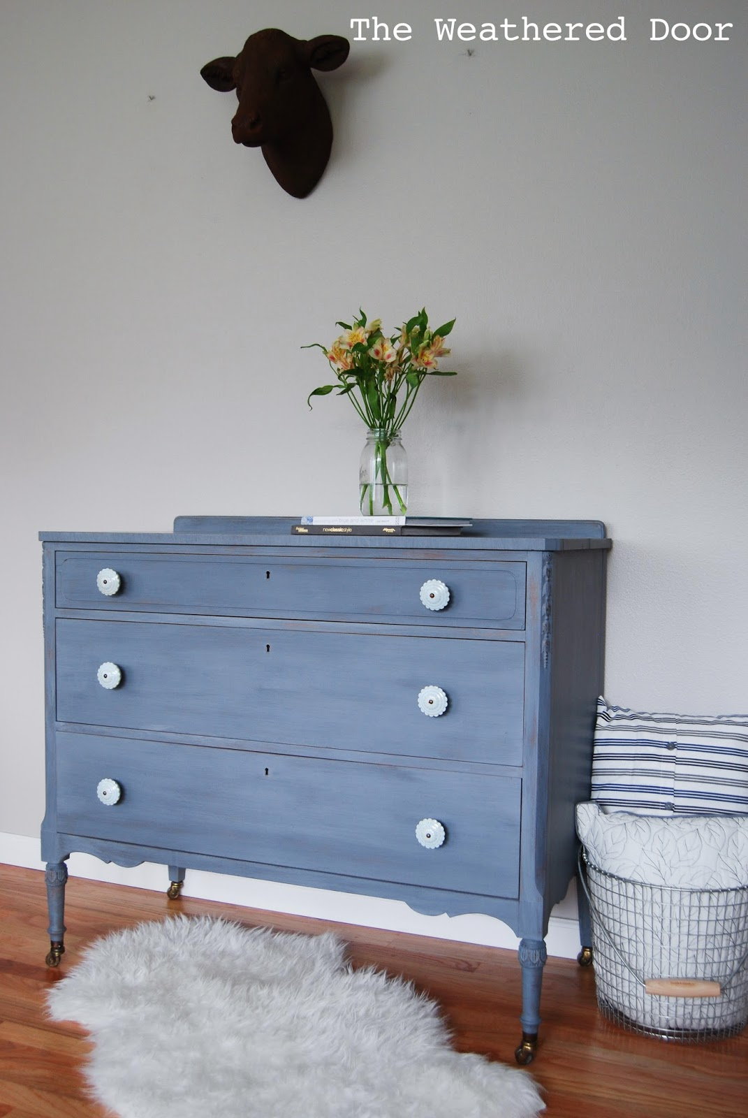 A Grey Blue Purple Dresser With Soft Blue Knobs The