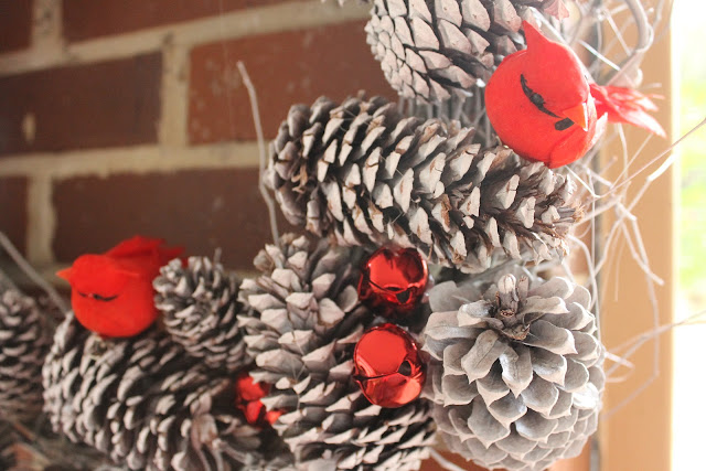 red bird and pinecone wreath