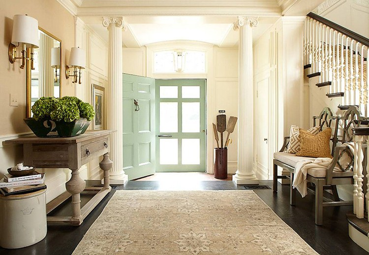 Sure fit slipcovers decorating a welcoming front entry for Front foyer design ideas