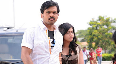 Karthi and Praneetha hot Stills in Film Saguni