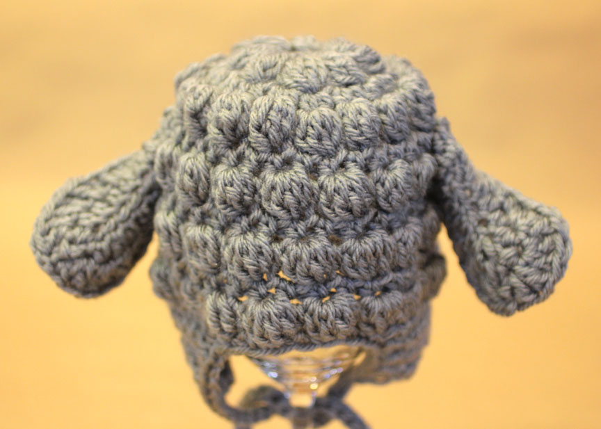 Feel free to add your own embellishments. I went ahead and added a felt  face to my hat! I cut out the face e3e837bc84a