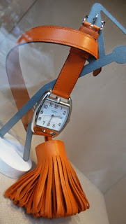 Hermès Watch with Orange Leather strap and Tassle