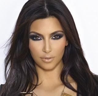 Fashionista Kim Kardashian glamorous style with a gorgeous smokey eye.