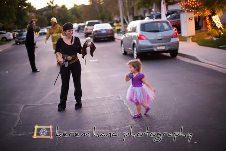 Mommy Pirate walking her Ballerina Witch Daughter
