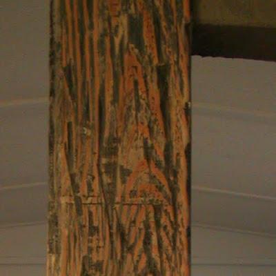 exposed rustic distressed wood beam