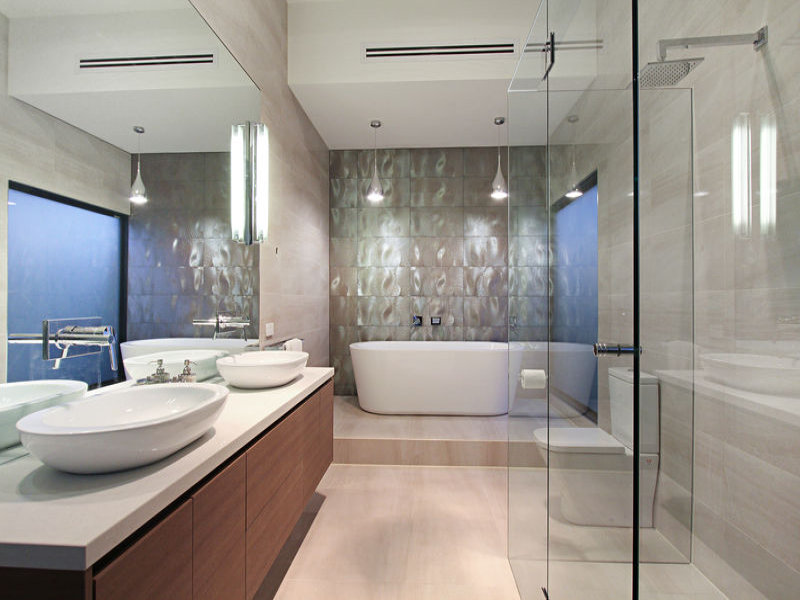 picture of modern bathroom with two sinks white bathtub and glassy shower cabin small contemporary home bathroom melbourne