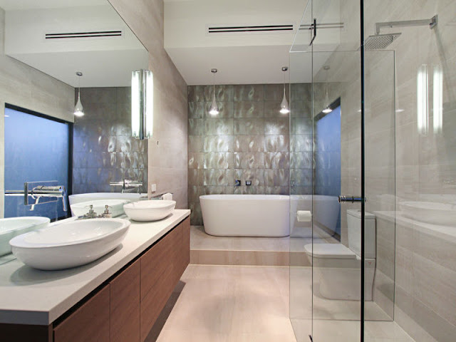 Picture of modern bathroom with two sinks, white bathtub and glassy shower cabin