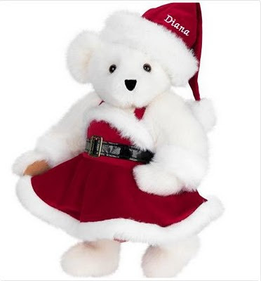photo of white teddy bear in christmas dress
