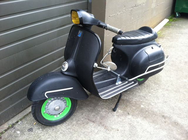 Great flat black Piaggio scooter.