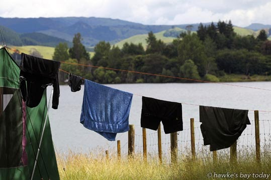 Campers make themselves at home, campers' washing line at Tutira photograph
