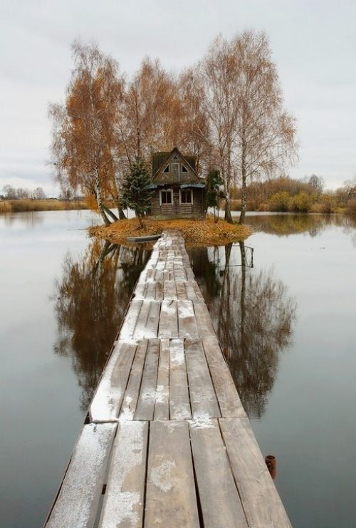 Island House in Finland with a dock leading to it.