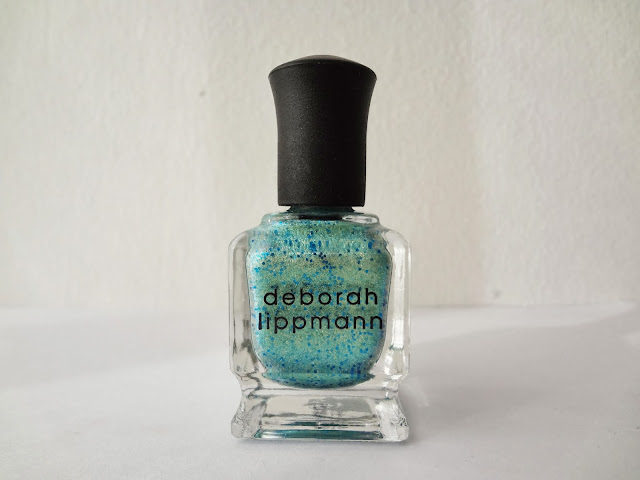 Deborah Lippmann nail polish in Mermaid's dream is a green-gold shimmery aqua blue with blue glitters.