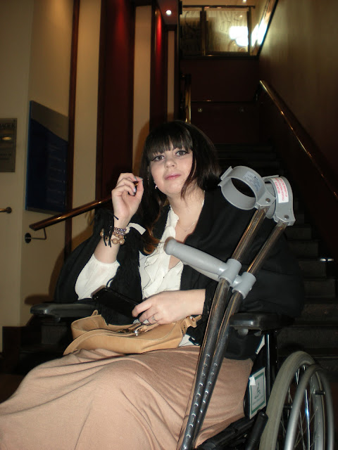 a girl in a wheelchair with cructhes