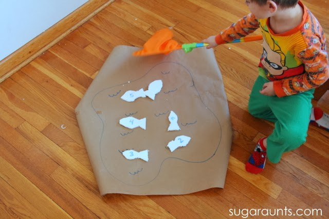 Scoop fish in a penguin themed counting activity for preschoolers.