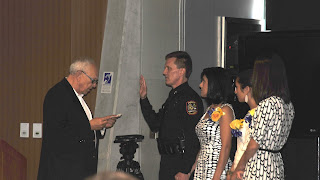 Dye is sworn in as Grand Prairie by Mayor Charles England in July 2011.