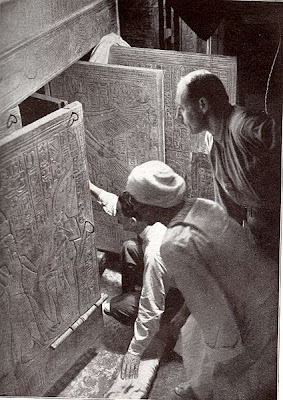 Howard Carter (kneeling) entering the tomb of Tutamkhamun
