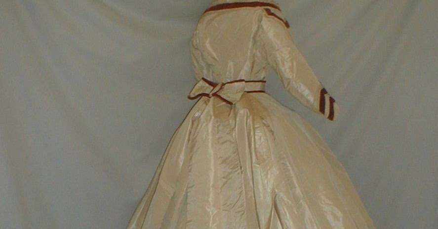 All The Pretty Dresses 1865 Ivory Dress With Red Velvet Trim